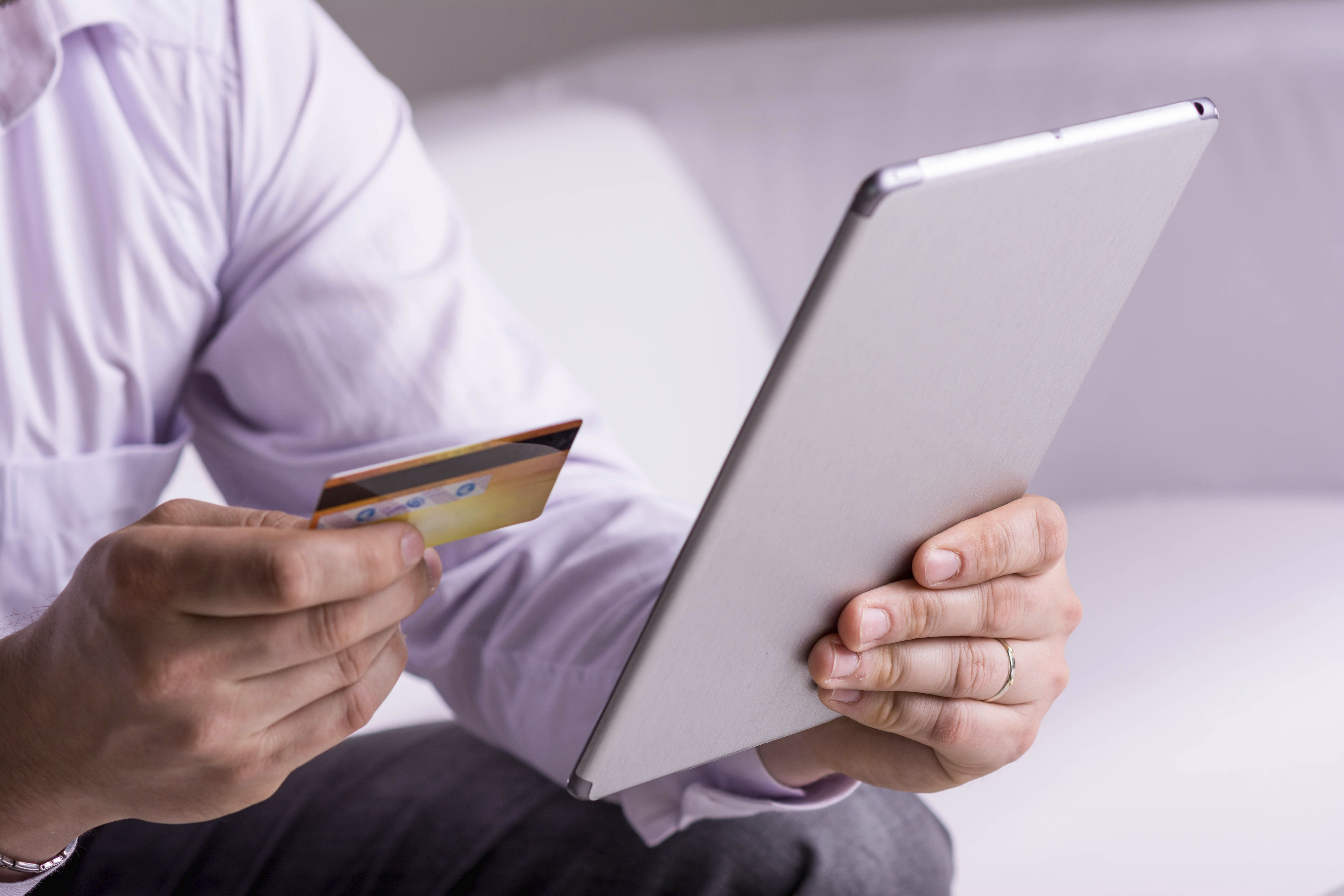 Man with tablet and a credit card photo